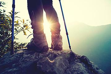 Small gettyimages successful hiker legs on mountain peak rock 638233384 izf 2019 05 23 online 800x600